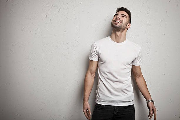 A guy wearing a white t-shirt